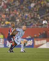 Colorado Rapids forward Conor Casey (9) holds position on New England Revolution defender Darrius Barnes (25). The New England Revolution tied the Colorado Rapids, 1-1, at Gillette Stadium on May 16, 2009.