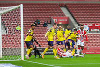 21st November 2020; Bet365 Stadium, Stoke, Staffordshire, England; English Football League Championship Football, Stoke City versus Huddersfield Town; Carel Eiting of Huddersfield Town clears the ball from close in