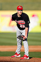 Brooks McDowell (25) of the Southern Illinois University- Edwardsville Cougars reads the pitch signs during a game against the Missouri State Bears at Hammons Field on March 10, 2012 in Springfield, Missouri. (David Welker / Four Seam Images)