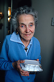 Haringey resident Mrs Layton receives a pre-cooked meal from the council's Meals on Wheels service.