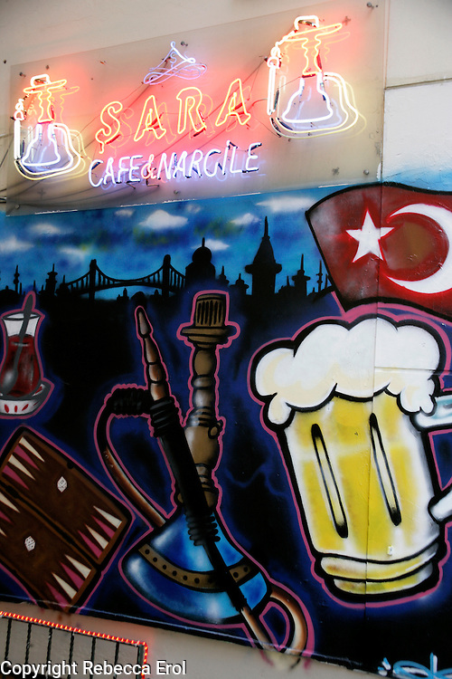 Wall mural advertising a cafe with hookah pipes in Beyoglu, Istanbul, Turkey