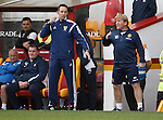 Motherwell's Stuart McCall told to get back by the fourth official Barry Cook