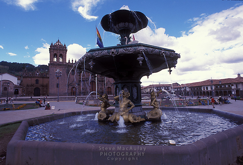 Fountain in Plaza de Armas with Cathedral in background, Cusco, Peru