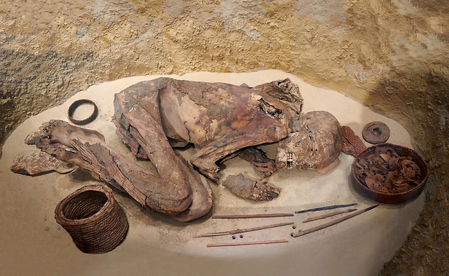 Ancient Egyptian Predynastic burial pit with deceased skeleton lying on side, Circa 3100 BC. Egyptian Museum, Turin.