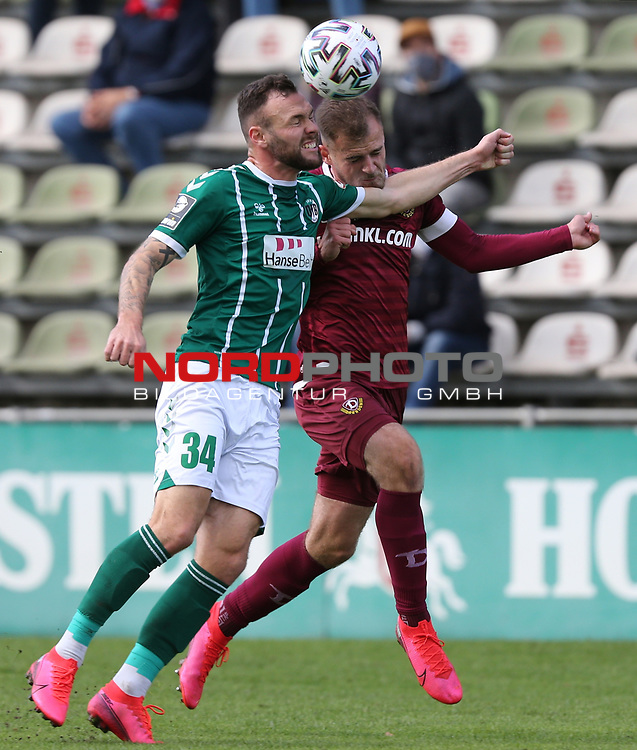 17.10.2020, Dietmar-Scholze-Stadion an der Lohmuehle, Luebeck, GER, 3. Liga, VfB Luebeck vs SG Dynamo Dresden <br /> <br /> im Bild / picture shows <br /> Patrick Hobsch (VfB Luebeck) im Zweikampf gegen Max Kulke (SG Dynamo Dresden) <br /> <br /> DFB REGULATIONS PROHIBIT ANY USE OF PHOTOGRAPHS AS IMAGE SEQUENCES AND/OR QUASI-VIDEO.<br /> <br /> Foto © nordphoto / Tauchnitz