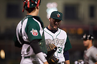 Fort Wayne TinCaps relief pitcher Dan Dallas (38) talks to Blake Hunt (12) as they walk off the field during a Midwest League game against the Quad Cities River Bandits at Parkview Field on May 3, 2019 in Fort Wayne, Indiana. Quad Cities defeated Fort Wayne 4-3. (Zachary Lucy/Four Seam Images)