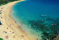 Tourists enjoying a sunny day walking, swimming and snorkeling at Kaanapali beach, Maui