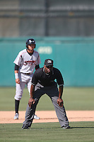 Umpire Malachi Moore handles the calls on the bases during the California League game between the Lake Elsinore Storm and the Inland Empire 66'ers at San Manuel Stadium on May 27, 2015 in San Bernardino, California. Lake Elsinore defeated Inland Empire, 12-9. (Larry Goren/Four Seam Images)