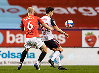Bolton Wanderers' Shaun Miller (right) holds off Salford City's Tom Clarke<br /> <br /> Photographer Andrew Kearns/CameraSport<br /> <br /> The EFL Sky Bet League Two - Bolton Wanderers v Salford City - Friday 13th November 2020 - University of Bolton Stadium - Bolton<br /> <br /> World Copyright © 2020 CameraSport. All rights reserved. 43 Linden Ave. Countesthorpe. Leicester. England. LE8 5PG - Tel: +44 (0) 116 277 4147 - admin@camerasport.com - www.camerasport.com
