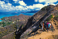 Hikers stop to enjoy the beautiful view from the Lanikai Ridge Trail. The windward coastline of Oahu can be seen from this vantage point.