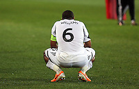Thursday 27 February 2014<br /> Pictured: A disappointed Swansea captain Ashley WIlliams sits on the pitch after his team conceded a third goal<br /> Re: UEFA Europa League, SSC Napoli v Swansea City FC at Stadio San Paolo, Naples, Italy.