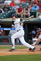 Devin Mann (7) of the Louisville Cardinals follows through on his swing against the Florida State Seminoles in Game Eleven of the 2017 ACC Baseball Championship at Louisville Slugger Field on May 26, 2017 in Louisville, Kentucky. The Seminoles defeated the Cardinals 6-2. (Brian Westerholt/Four Seam Images)