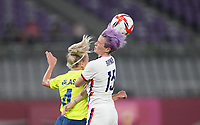 TOKYO, JAPAN - JULY 20: Megan Rapinoe #15 of the United States heads a ball during a game between Sweden and USWNT at Tokyo Stadium on July 20, 2021 in Tokyo, Japan.