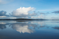 Reflection of clouds on Traigh Lingeigh beach, North Uist, Outer Hebrides, Scotland