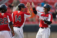 Carolina Mudcats hitting coach Ryan Jackson #14 high fives Dave Sappelt #6 after his game winning hit in the bottom of the 9th inning against the Jacksonville Suns at Five County Stadium May 16, 2010, in Zebulon, North Carolina.  Photo by Brian Westerholt /  Seam Images