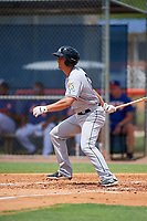 GCL Marlins right fielder Corey Bird (19) follows through on a swing during a game against the GCL Mets on August 3, 2018 at St. Lucie Sports Complex in Port St. Lucie, Florida.  GCL Mets defeated GCL Marlins 3-2.  (Mike Janes/Four Seam Images)