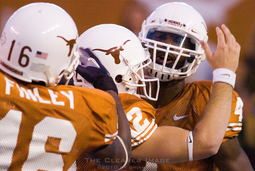 30 September 2006: Texas receiver Limas Sweed (#4) is congratulated by quarterback Colt McCoy (#12) and tight end Jermichael Finley (#16) after catching a long touchdown pass during the Longhorns 56-3 victory over the Sam Houston State Bearkats at Darrell K Royal Memorial Stadium in Austin, TX.
