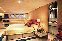 The king bedroom and en-suite bathroom on a luxurious private motor cruiser.