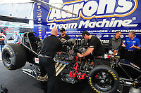 May 20, 2011; Topeka, KS, USA: Crew members work on the car of NHRA funny car driver Jack Beckman in the pits during qualifying for the Summer Nationals at Heartland Park Topeka. Mandatory Credit: Mark J. Rebilas-