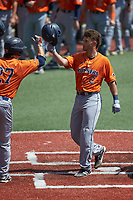 Joshua Lamb (2) of the UTSA Roadrunners is gteeted at home plate by teammate Dylan Rock (27) after hitting a home run against the Charlotte 49ers at Hayes Stadium on April 18, 2021 in Charlotte, North Carolina. (Brian Westerholt/Four Seam Images)