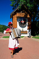 Kimberley, BC, British Columbia, Canada - Woman playing Accordion on Platzl in front of Cuckoo Clock.  Kimberley is known as the Bavarian City of the Rockies