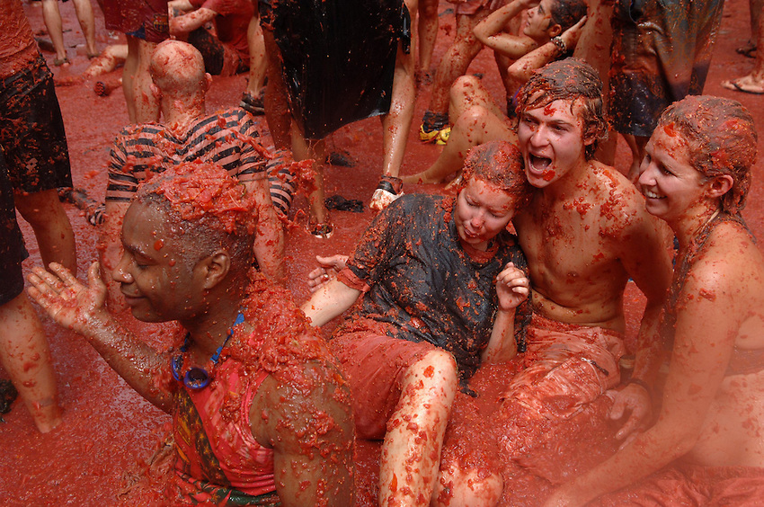 BUNYOL, SPAIN - AUGUST 31: People immersed in tomato juice in the Tomatina August 31, 2005 in Bunyol, Valencia, Spain. Approximately 45,000 people pelted each other with a little over 100.000 kilograms of tomatoes. The tomatina is known as the world's largest tomato battle. Photo by Ander Gillenea