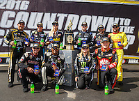 Sep 18, 2016; Concord, NC, USA; NHRA top fuel drivers (front row from left) Steve Torrence , Antron Brown , Brittany Force , Doug Kalitta (back row from left) Tony Schumacher , Clay Millican , Leah Pritchett , Richie Crampton , J.R. Todd and Shawn Langdon pose for a photo with the championship trophy prior to the Carolina Nationals at zMax Dragway. Mandatory Credit: Mark J. Rebilas-USA TODAY Sports
