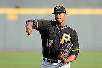 Pitcher Miguel Ferreras (17) of the Bristol Pirates warms up before a game against the Greeneville Astros on Friday, July 25, 2014, at Pioneer Park in Greeneville, Tennessee. Greeneville won, 9-4. (Tom Priddy/Four Seam Images)