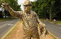 Bronzed statue of Hugh McManaway at the intersection of Queens and Queens in the Myers Park neighborhood in Charlotte, NC. Myers Park is one of the premier neighborhoods in North America and known for its large canopy of trees.