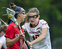 Newton, Massachusetts - May 19, 2018: NCAA Division I tournament, third round. In overtime, Boston College (white) defeated Stony Brook University (red/blue), 12-11, at Newton Campus Lacrosse Field.