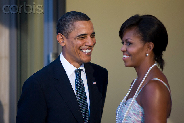 24 Sep 2009, Pittsburgh, Pennsylvania, USA --- U.S. President Barack Obama and first lady Michelle Obama wait for arriving leaders at the Phipps Conservatory, before an opening reception and working dinner for heads of delegation, at the Pittsburgh G20 Summit in Pittsburgh, Pennsylvania.  --- Image by © Brooks Kraft/Corbis