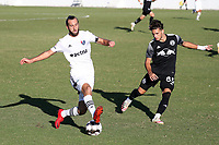 RICHMOND, VA - SEPTEMBER 30: Marios Lomis #9 of North Carolina FC is defended by Joey Zalinsky #85 of New York Red Bulls II during a game between North Carolina FC and New York Red Bulls II at City Stadium on September 30, 2020 in Richmond, Virginia.