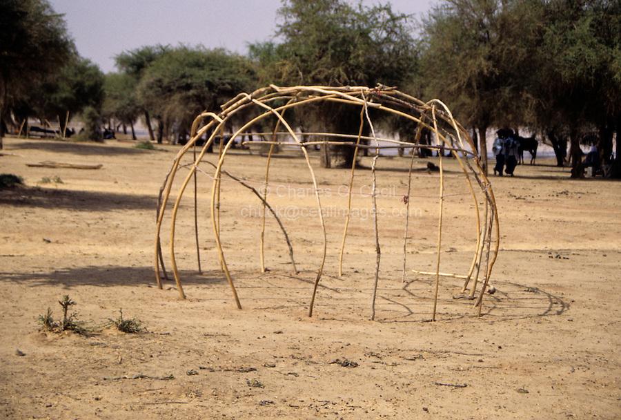 Akadaney, Central Niger, West Africa.  Fulani Nomads.  Framework of sleeping enclosure, formed of curved sticks.