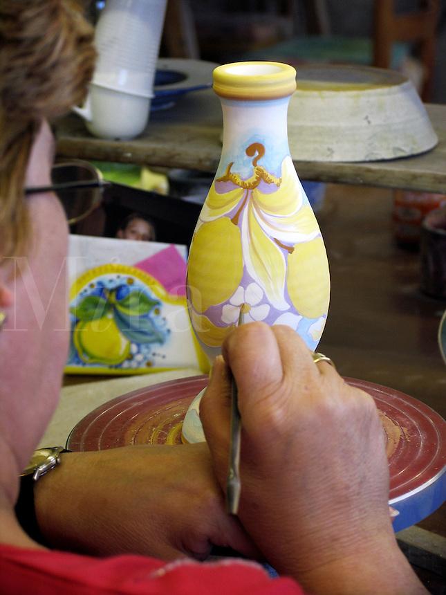 Hand painting of ceramics designs in ceramics factory in Deruta, Ital