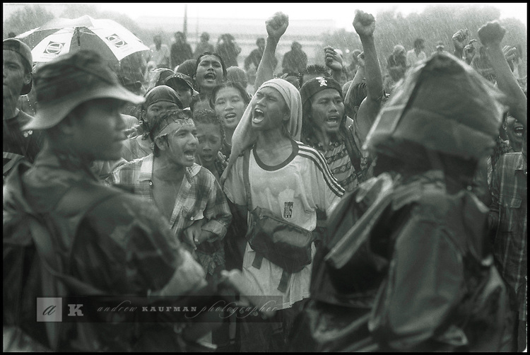Summer '98-- Jakarta, Indonesia -- A  local group of men go to the MPR to protest against President Suharto in the rain.