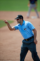 Umpire Thomas Fornarola points to Lowell Spinners coach Nate Spears (not shown) after ejecting him from the game during a game against the Batavia Muckdogs on July 15, 2018 at Dwyer Stadium in Batavia, New York.  Lowell defeated Batavia 6-2.  (Mike Janes/Four Seam Images)