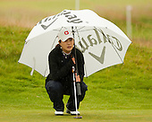 Meena Lee lines up her putt on the 16th green during the first round play of the  Ricoh Woman's British Open to be played over the Championship Links from 28th to 31st July 2011; Picture Stuart Adams, SAFOTO. www.safoto.co.uk; 28th July 2011