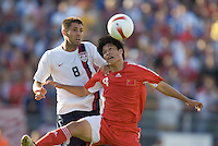 Clint Dempsey battles Zhang Yaokun for a header. The USA defeated China, 4-1, in an international friendly at Spartan Stadium, San Jose, CA on June 2, 2007.