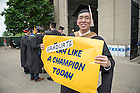 May 17, 2015; Mendoza College of Business MBA graduate Tony Cheng celebrates outside Notre Dame Stadium after the 2015 Commencement ceremony. (Photo by Matt Cashore/University of Notre Dame)