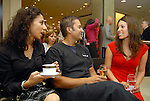 From left: Fatema Khan and her husband Wasim Khan chat with Julie Garza at the Recipe for Success Tea & Temptations fashion show at Saks Fifth Avenue Thursday Nov. 19,2009. (Dave Rossman/For the Chronicle)