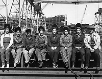 Line up of some of women welders including the women's welding champion of Ingalls.  Ingalls Shipbuilding Corp., Pascagoula, MS, 1943.  Spencer Beebe.  (Women's Bureau)<br /> Exact Date Shot Unknown<br /> NARA FILE #:  086-WWT-85-35<br /> WAR & CONFLICT BOOK #:  809