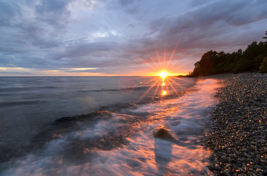 A Lake Michigan sunset from the beautiful shoreline at Fayette. Storm clouds moved away from the horizon just in time for the sun to make one final appearance. Fayette Historic State Park