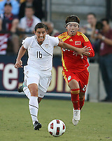 Ali Krieger #16 of the USA WNT holds back Yasha Gu #24 of the PRC WNT during an international friendly match at KSU Soccer Stadium, on October 2 2010 in Kennesaw, Georgia. USA won 2-1.