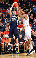 CHARLOTTESVILLE, VA- December 3: Jan van der Kooij #33 of the Longwood Lancers shoots over Mike Scott #23 of the Virginia Cavaliers during the game on December 27, 2011 at the John Paul Jones Arena in Charlottesville, Virginia. Virginia defeated Longwood 86-53. (Photo by Andrew Shurtleff/Getty Images) *** Local Caption *** Mike Scott;Jan van der Kooij