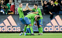 LOS ANGELES, CA - OCTOBER 29: Nicolas Lodeiro #10 of the Seattle Sounders FC scores a goal and celebrates with teammates Cristian Roldan #7 and Brad Smith #11 during a game between Seattle Sounders FC and Los Angeles FC at Banc of California Stadium on October 29, 2019 in Los Angeles, California.