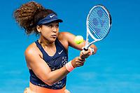14th February 2021, Melbourne, Victoria, Australia; Naomi Osaka of Japan returns the ball during round 4 of the 2021 Australian Open on February 14 2020, at Melbourne Park in Melbourne, Australia.