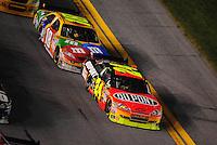 Feb 07, 2009; Daytona Beach, FL, USA; NASCAR Sprint Cup Series driver Jeff Gordon (24) leads Kyle Busch during the Bud Shootout at Daytona International Speedway. Mandatory Credit: Mark J. Rebilas-