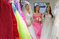 """COPY BY TOM BEDFORD<br /> Pictured L-R: Members of staff Sara Morris, Michelle Curry and Lara Williams, who have been trying on some of the dresses at the John Pye Auctions warehouse in Pyle, south Wales, UK.<br /> Re: A bride cried tears of joy after her missing wedding dress was found among a pile of 20,000 gowns in a warehouse.<br /> Meg Stamp, 27, paid £1,300 for the beautiful ivory lace dress but it  was seized by liquidators after a bridal company went bust.<br /> It was boxed up along with 20,000 others and due to be sold for a knock-down price at auction.<br /> But determined Meg banged on the auctioneer door saying: """"I want my dress back"""".<br /> Staff at John Pye auctioneers in Port Talbot spent three hours sifting through boxes until they finally found Meg's dream dress."""
