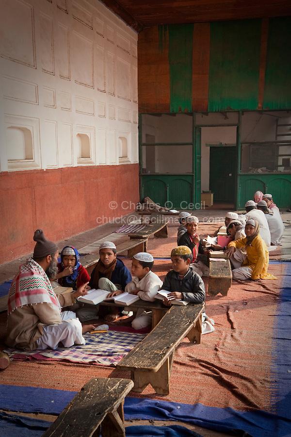 Agra, India.  Imam and Madrasa Students at the Jama Masjid (Friday Mosque).