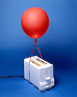 HEAT FROM TOASTER CAUSES BALLOON TO RISE<br /> Air in Balloon Is Heated by Toaster Coils.<br /> As the air in the balloon is heated, it expands, becoming less dense than the surrounding air causing the balloon to rise.